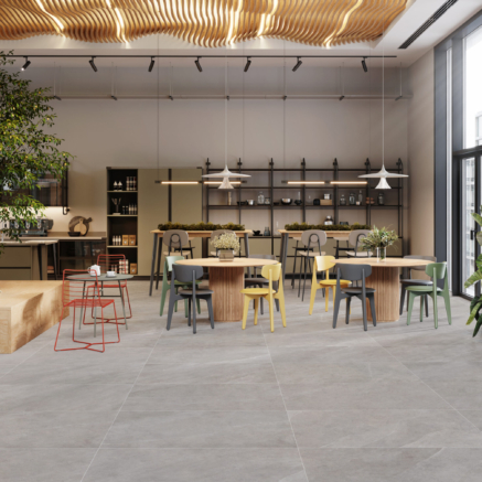 Interior of modern office cafe with multicolored tables and chairs. 3d rendering of modern office cafeteria.